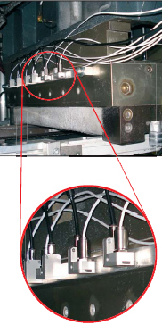 Sensing heads installed in a machinery with laminar air purge collars for temperature monitoring during thermoforming